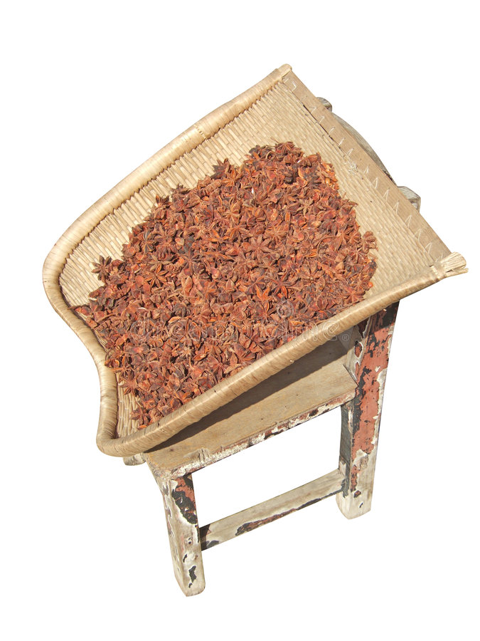 Aniseed, Dustpan and Stool. With white background royalty free stock photo