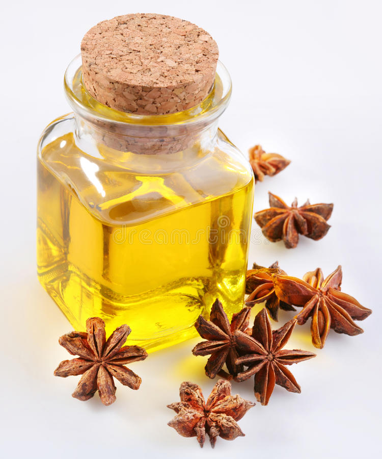 Aniseed oil with nuts. On a white background stock images