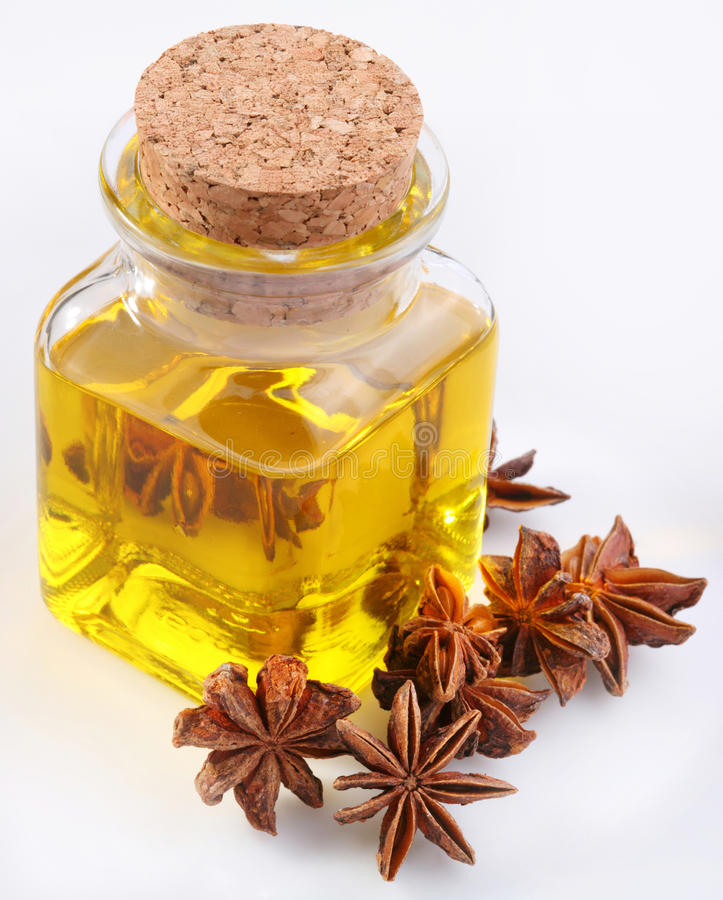 Aniseed oil with nuts. On a white background stock photography