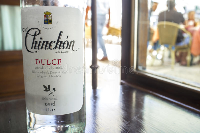 Anisette bottle served at main square cafe of Chinchon, Spain. Chinchon, Spain – Jun 2017: Anisette bottle served at main square cafe of Chinchon, near stock photography
