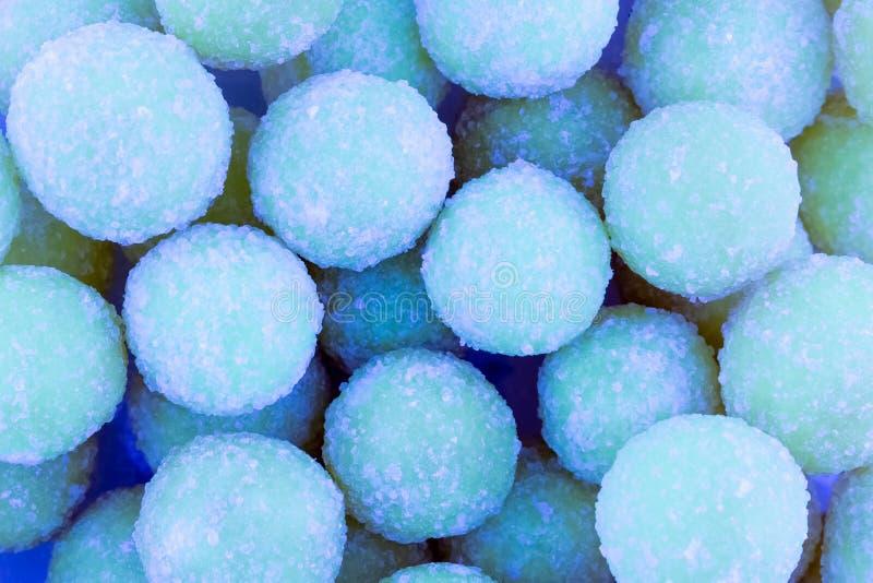 Aniversário redondo azul da base do projeto dos confeitos do projeto do teste padrão dos doces de açúcar do fundo colorido doce fotos de stock