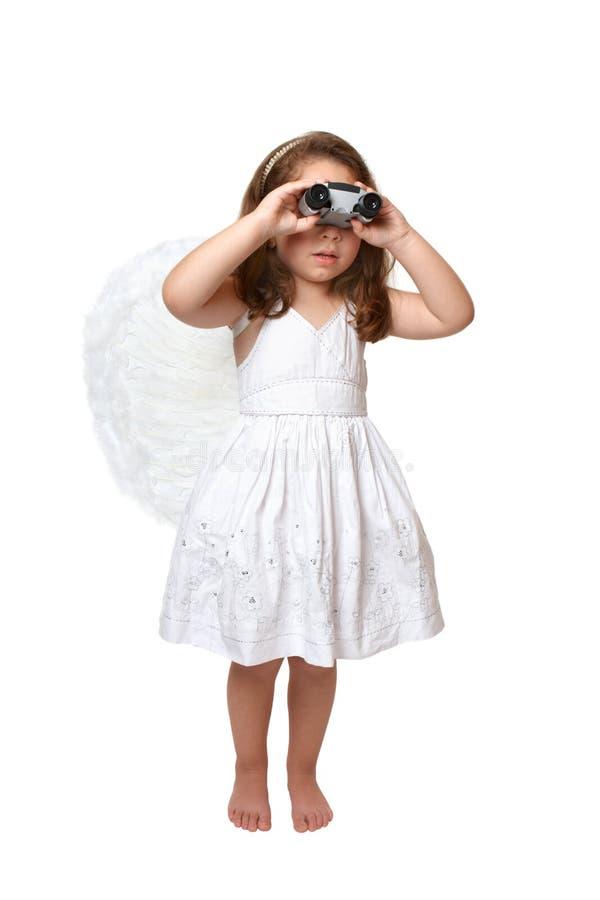 Anjo celestial que olha de observação através dos binóculos fotos de stock