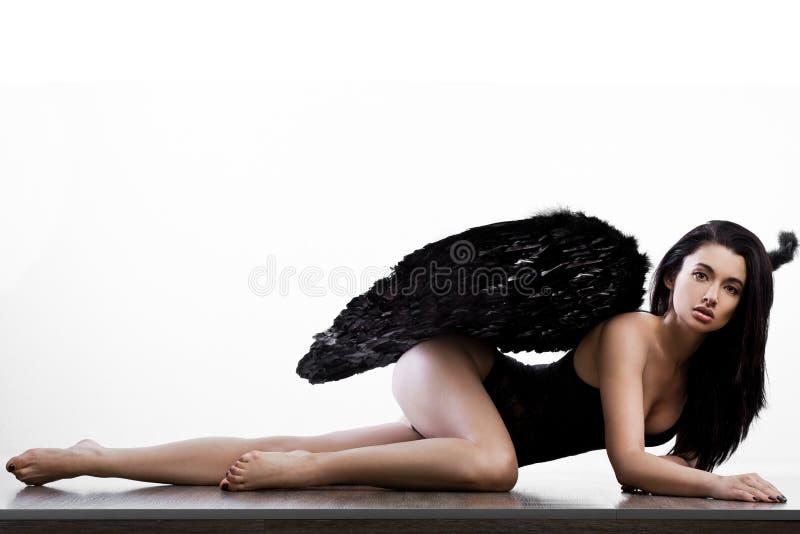 Anjo com as asas no branco imagens de stock royalty free