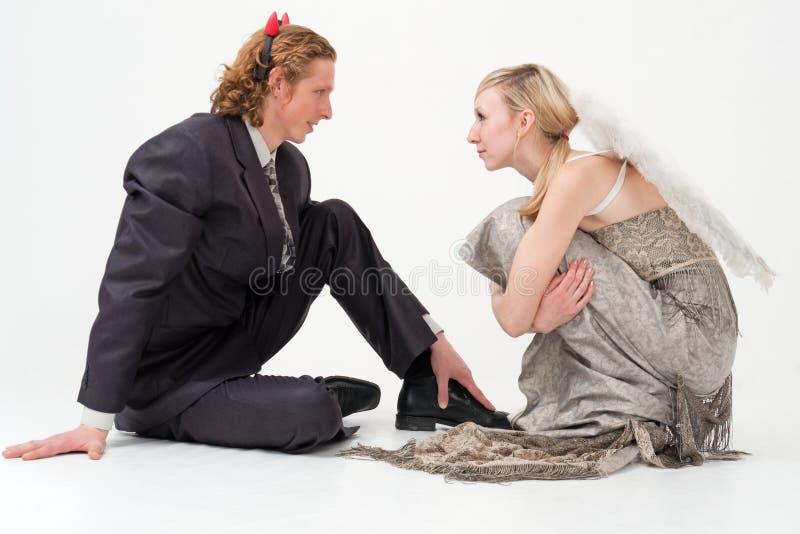 Anjo e assento do diabo imagem de stock royalty free