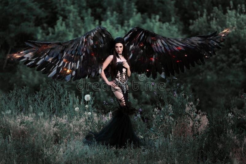 Anjo preto Menina-demônio bonito fotografia de stock royalty free
