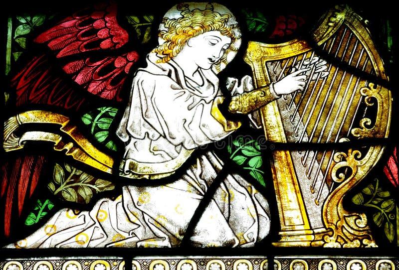 Anjo que faz a música (vitral) imagem de stock