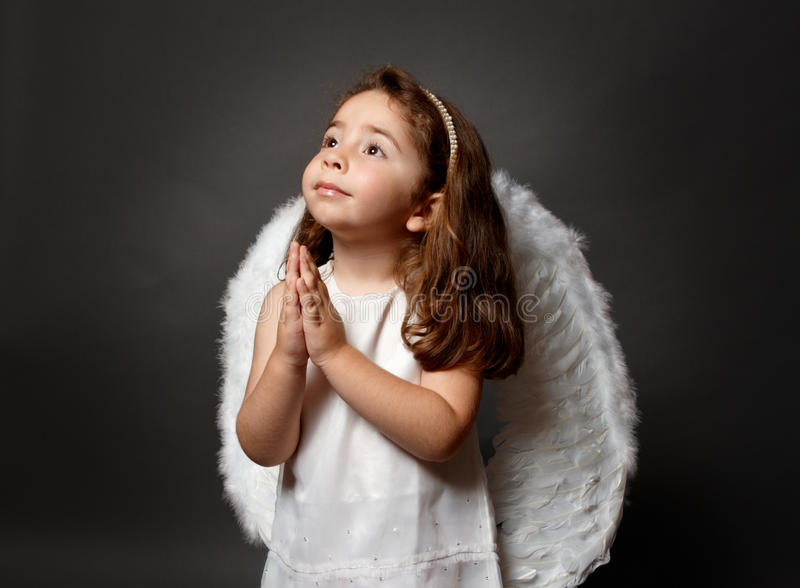 Anjo santamente que praying imagens de stock royalty free