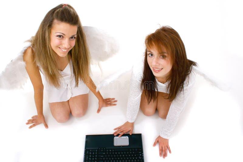 Anjos com teclado de computador fotos de stock