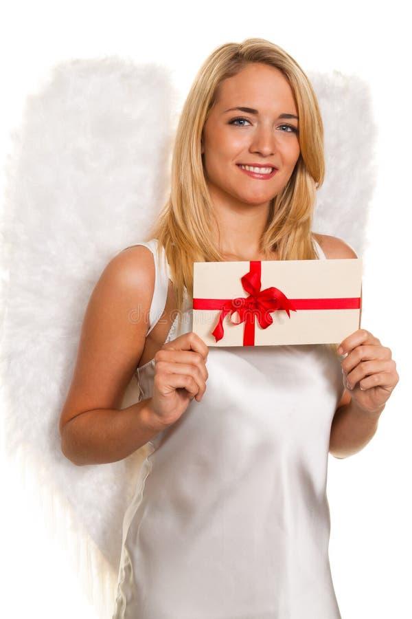 Anjos para o Natal com pacotes e presentes. imagem de stock royalty free