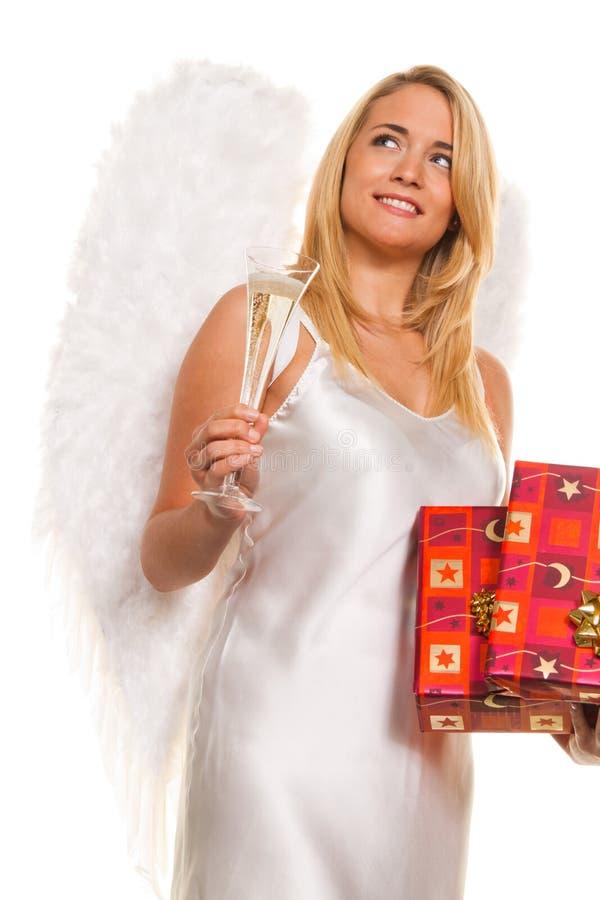 Anjos para o Natal com pacotes e presentes. foto de stock royalty free