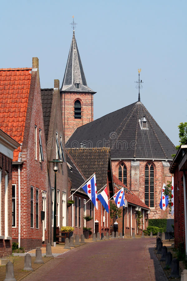 Anjum street. A typical street for a village in Friesland royalty free stock photos