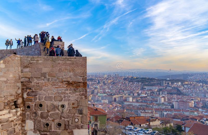 Ankara/Turkey-February 02 2019: Cityscape view from Ankara Castle in the sunset and people enjoying on the top of the castle stock photos