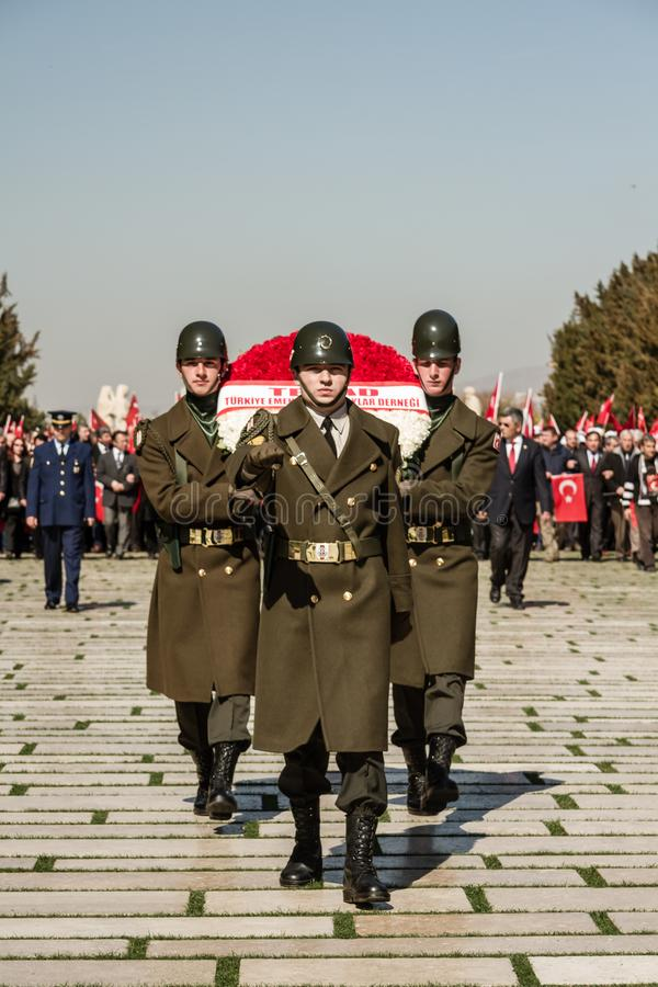ANKARA, TURKEY -MAR 15, 2014 : Honour Guards Carry Wreaths to Ataturk`s mausoleum. ANKARA, TURKEY -MAR 15, 2014 : Changing of the honour guard at Anitkabir stock photo