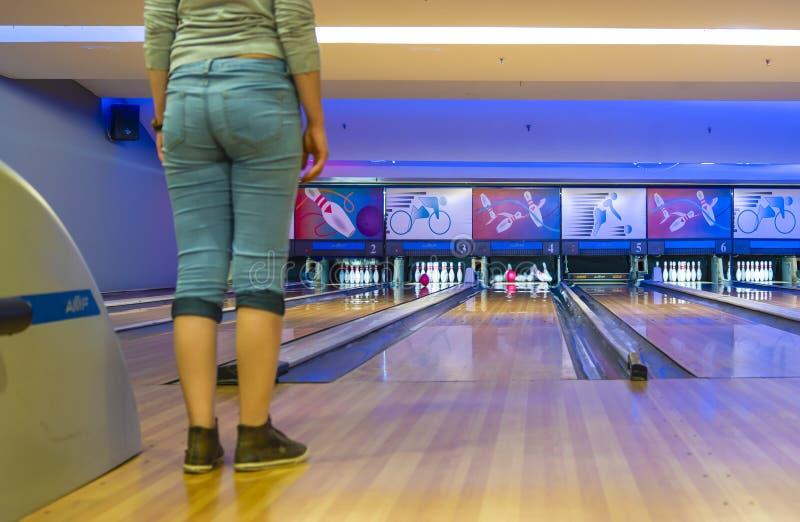 Ankara/Turkey-May 01 2019: Woman`s bowling ball hitting pins scoring a strike stock photos