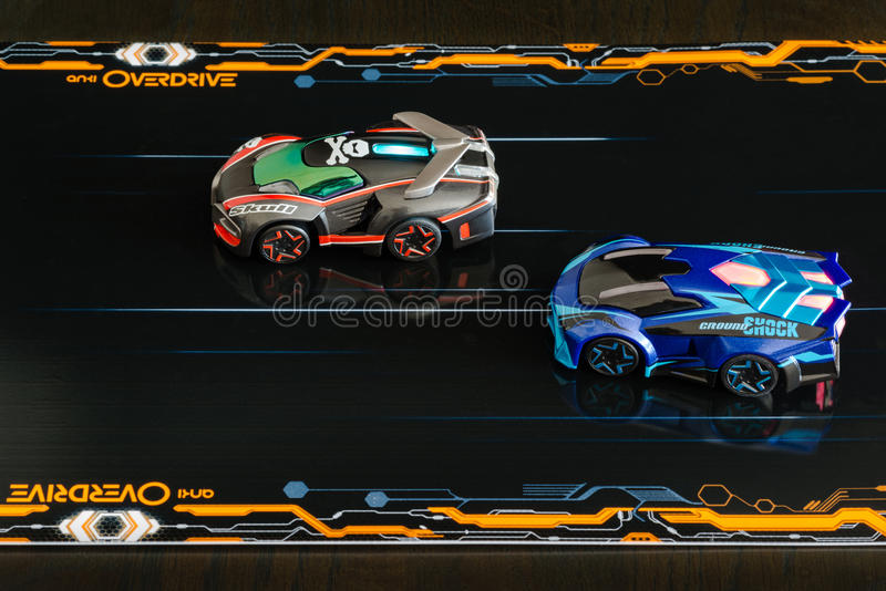 Anki Overdrive - modern toy car racing. Ostfildern, Germany - November 8, 2015: The new Anki Overdrive smart toy car racing is set up in a living room. The small stock images