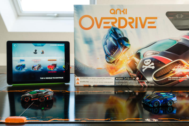 Anki Overdrive - modern toy car racing. Ostfildern, Germany - November 8, 2015: The new Anki Overdrive smart toy car racing is set up on a living room table royalty free stock image