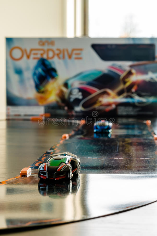 Anki Overdrive - modern toy car racing. Ostfildern, Germany - November 8, 2015: The new Anki Overdrive smart toy car racing is set up in a living room together royalty free stock photo