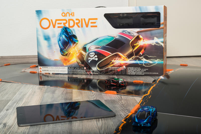 Anki Overdrive toy car racing. Ostfildern, Germany - November 1, 2015: Test drive of the new Anki Overdrive smart toy car racing using an app on the Apple iPad stock photography