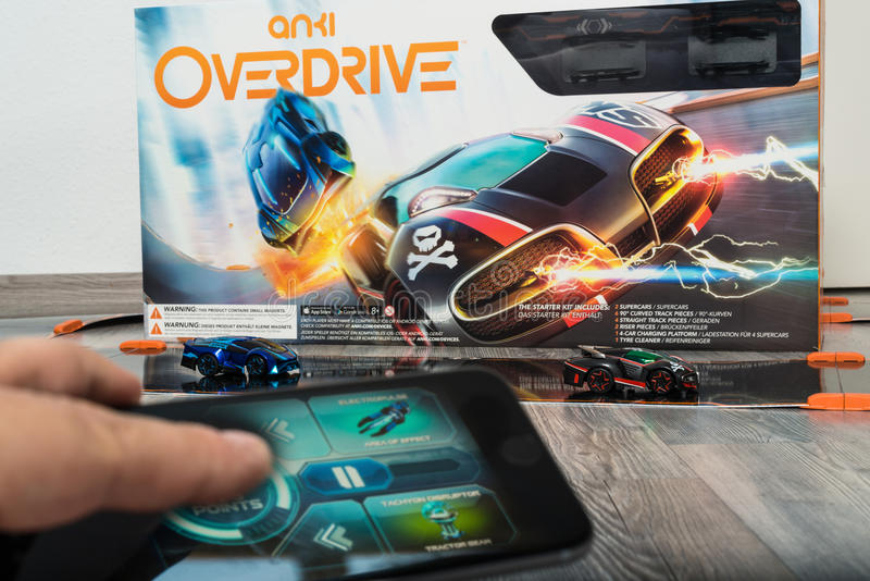 Anki Overdrive toy car racing. Ostfildern, Germany - November 1, 2015: Test drive of the new Anki Overdrive smart toy car racing using an app on the Apple iPhone stock images