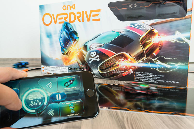 Anki Overdrive toy car racing. Ostfildern, Germany - November 1, 2015: Test drive of the new Anki Overdrive smart toy car racing using an app on mobile phones or royalty free stock photo