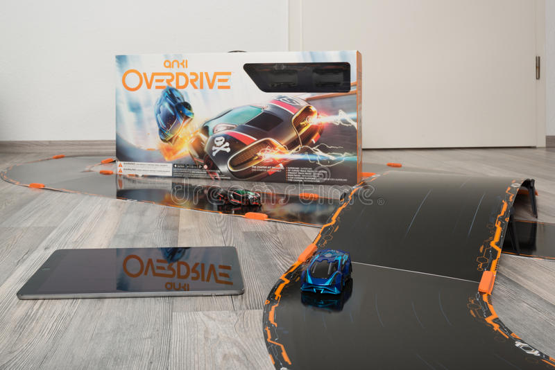 Anki Overdrive toy car racing. Ostfildern, Germany - November 1, 2015: Test drive of the new Anki Overdrive smart toy car racing using an app on mobile phones or royalty free stock photos