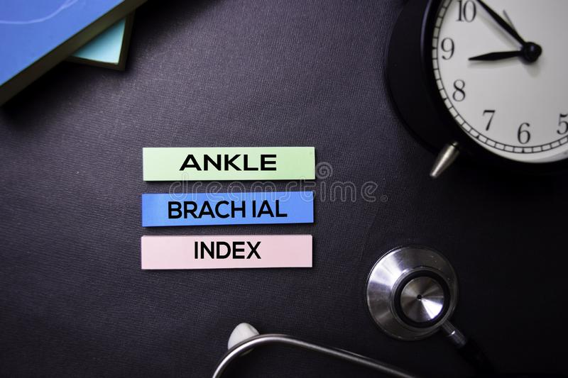 Ankle Brachial Index text on Sticky Notes. Top view isolated on black background. Healthcare/Medical concept stock photo