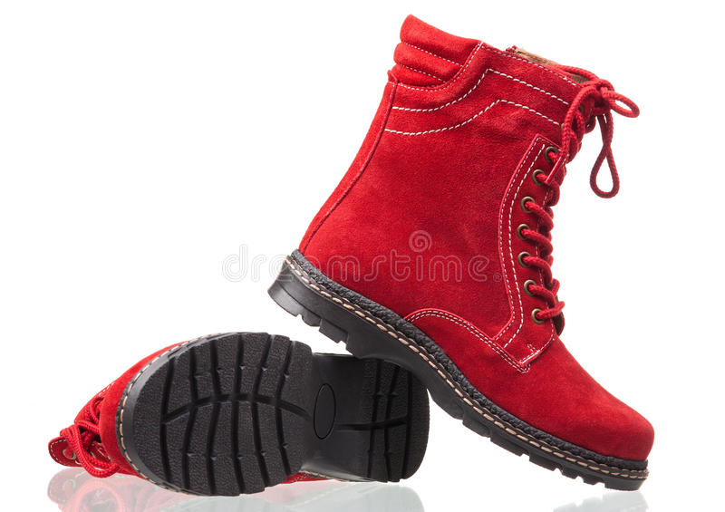 Ankle high women boots over white royalty free stock image