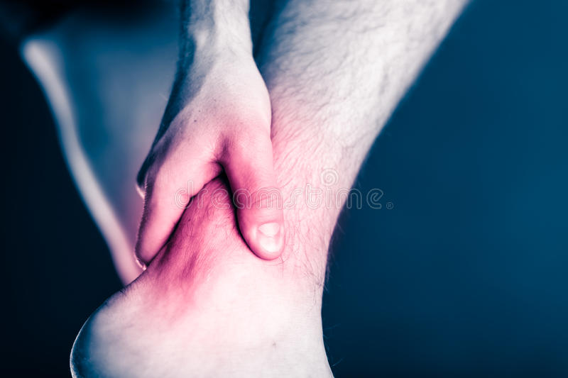Ankle pain, physical injury painful leg royalty free stock photography