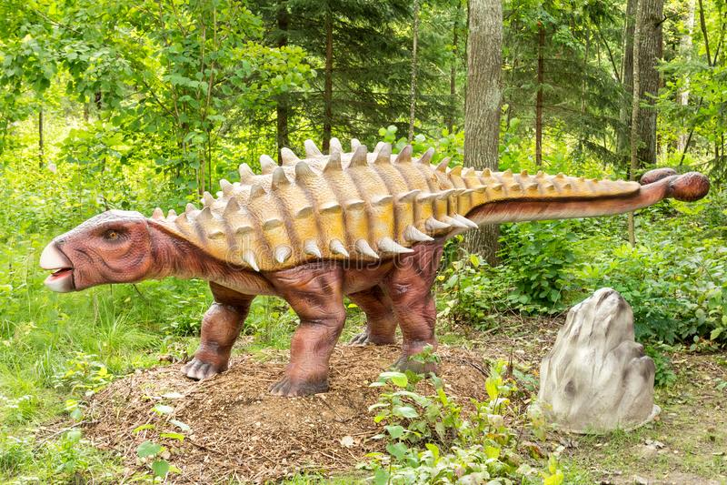 Ankylosaurus dinosaur in a green forest. Statue of Ankylosaurus dinosaur in a green forest royalty free stock photos