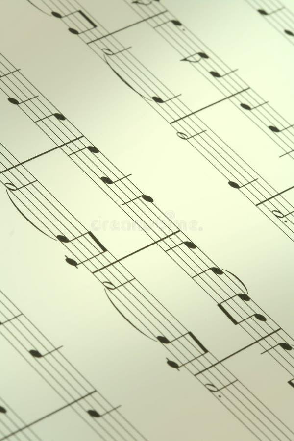 anmärkning för bakgrundsmusik arkivbild