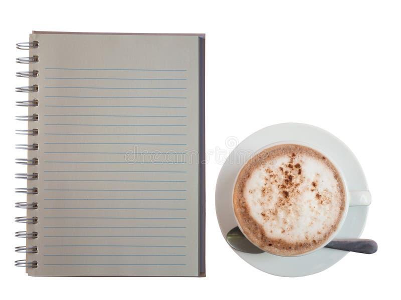 Anmärkningsbok och kakaodrink arkivbilder
