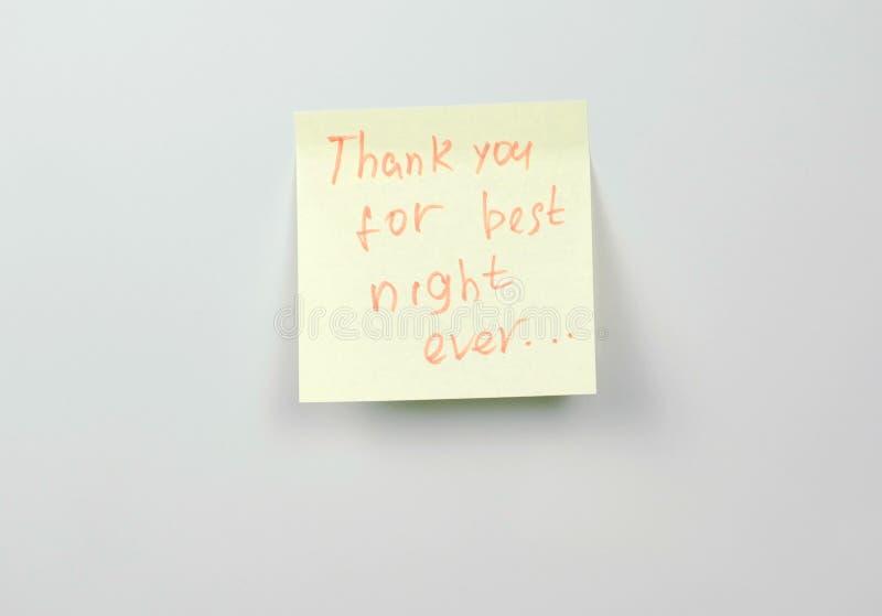 Anmerkung über Papierblätter des gelben Aufklebers mit Wörtern danken Ihnen für die beste Nacht überhaupt lizenzfreies stockfoto