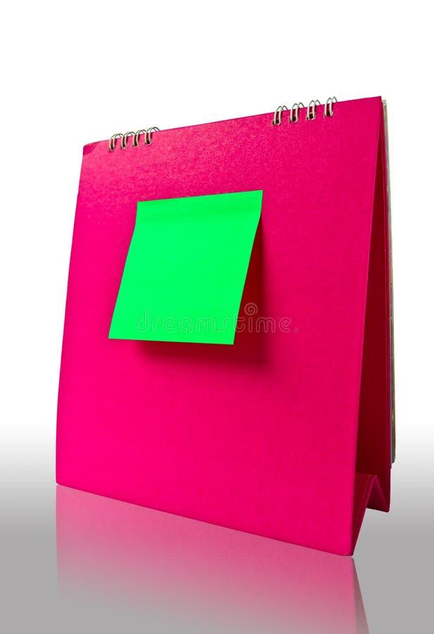 Anmerkung über rosafarbenen Kalender lizenzfreie stockfotografie