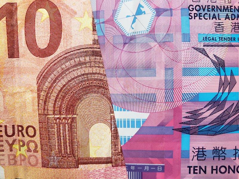 Annäherung an europäische Banknote von zehn Euro und Hong Kong-Banknote von zehn Dollar lizenzfreies stockbild