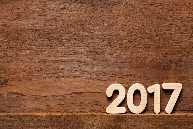 Année 2017 numérique sur le fond boisé images stock