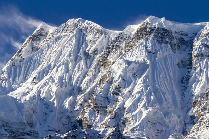 Annapurna III is a mountain in the Annapurna mountain range, and at 7,555 metres tall. Nepal, Himalayas.  royalty free stock images