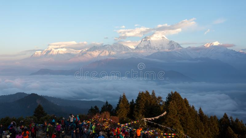 Annapurna, Nepal - November 14, 2018: Tourists meeting the dawn on Poon Hill 3210 m. It`s the famous view point in Gorepani stock photography