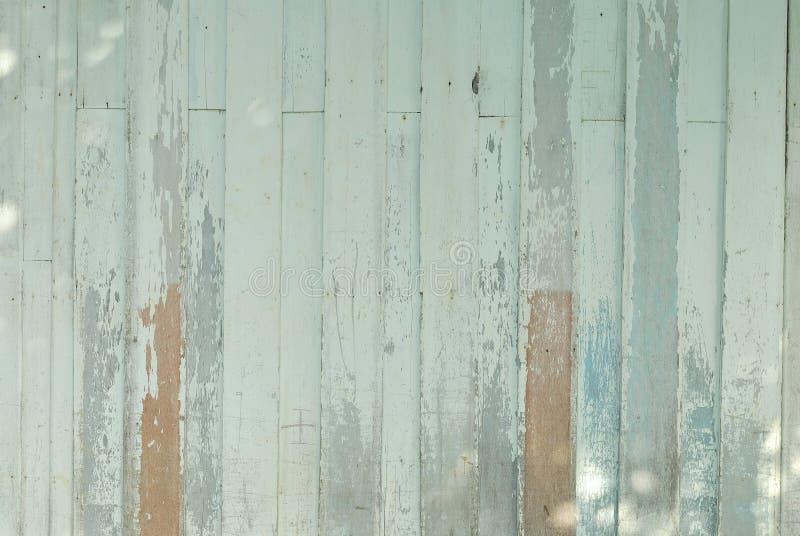 Annata marrone e verde della plancia di legno del fondo fotografie stock