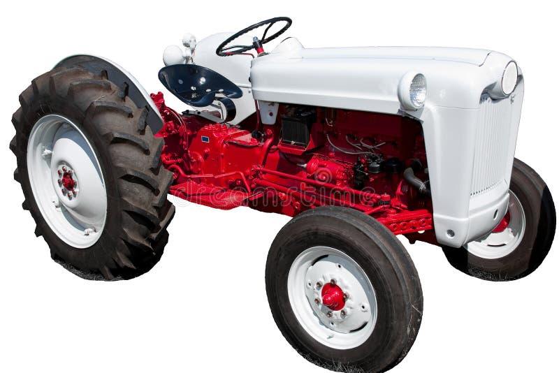 Annata rossa e trattore bianco isolato fotografia stock libera da diritti