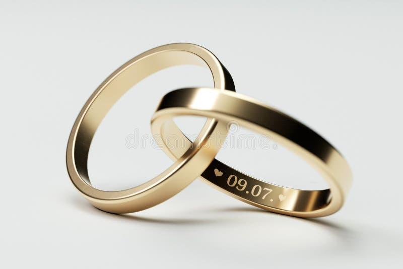 Anneaux de mariage d'or d'isolement avec la date 9 juillet photos libres de droits