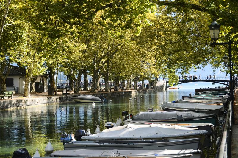 Annecy lake and city, bridge of the loves stock photos