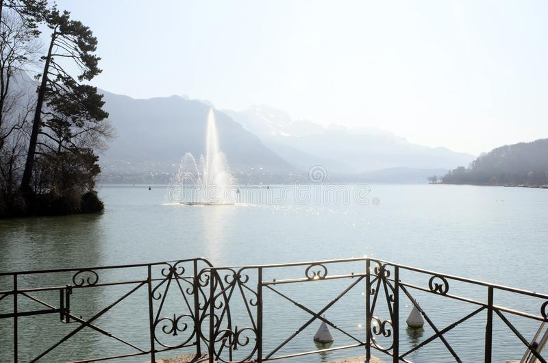 Annecy lake and water jet, France stock photography
