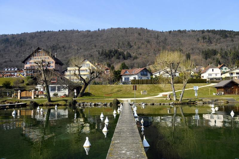 Annecy lake, west shore and houses royalty free stock photography