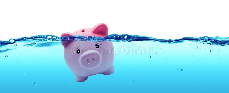 Annegamento della Banca Piggy fotografia stock