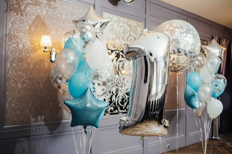 Large closeup inflatable ballon in the form of a number one royalty free stock photo