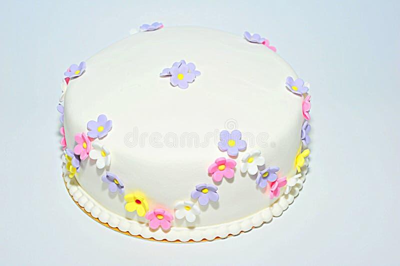 Anniversary fondant cake with flowers. Beautifully crafted fondant cake with floral theme royalty free stock photos