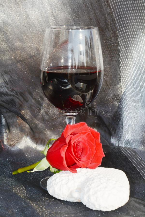 Anniversary image. Red wine, rose and heart stock photo