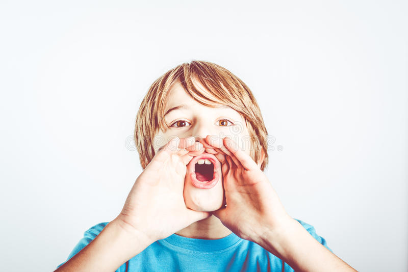 Announce. Child shout with cute expression royalty free stock image