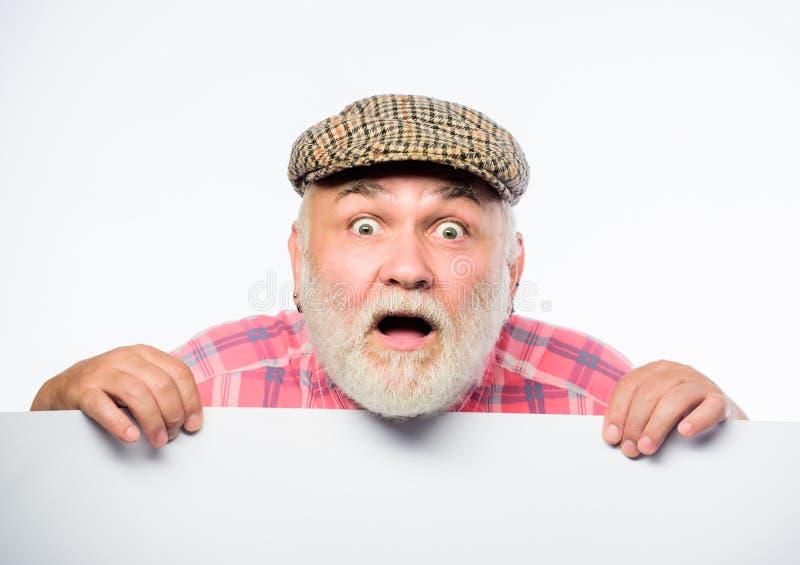 Announcement concept. Event announcement. Senior bearded emotional man peek out of banner place announcement. Pensioner stock images