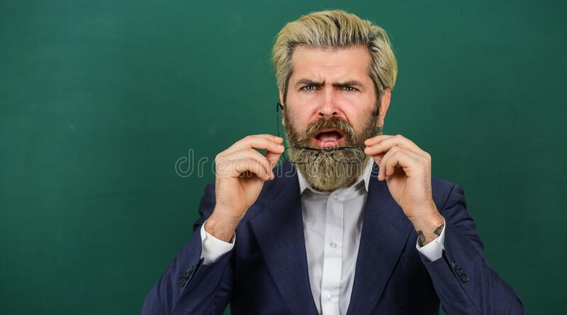 Announcement school courses. Introduced and welcomed by university. Teacher explain topic. Man teacher in front of. School chalkboard copy space. School stock image